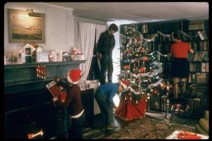 Family decorating their house for Christmas (1971)
