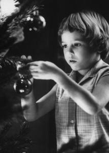 Daughter of Lt. Commander Joe Smith decorates their Christmas tree at Guantanamo Naval Base (1962)