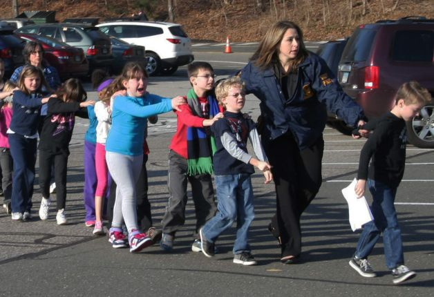 The iconic photo of children being escorted out of Sandy Hook Elementary, the location of a mass shooting last year.