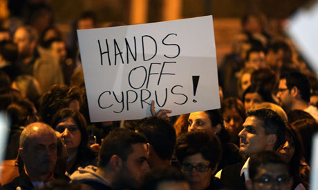 Protesters outside of parliament in Nicosia.