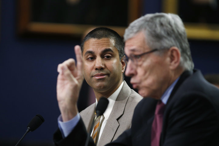 FCC Commissioner Pai listens to FCC Chairman Wheeler testify at House Appropriations Subcommittee hearing on Capitol Hill in Washington
